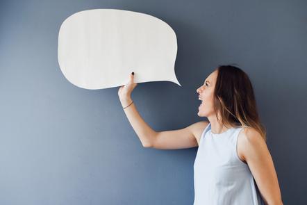 A woman holding a speech bubble