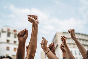 People with raised fists at a demonstration in the city