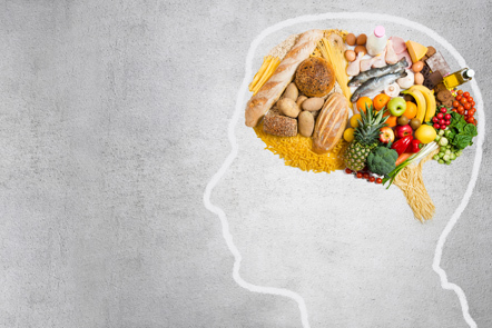 A variety of nutritious food in the shape of a brain placed inside a chalk outline of a human head.
