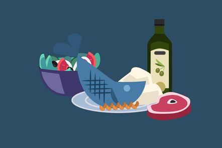 a table with a plate with fish in it, a salad bowl, meat and an olive oil bottle