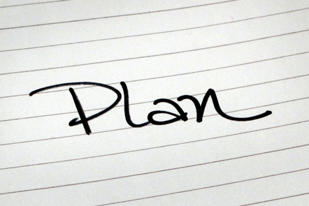 A page with the word 'Plan' written down.