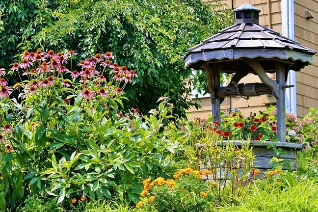 A wishing well in a garden