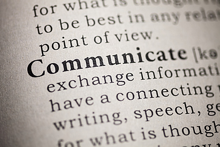 "The word ""communicate"" written in a dictionary."