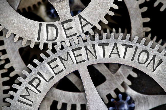 Gears with the words Idea and Implementation