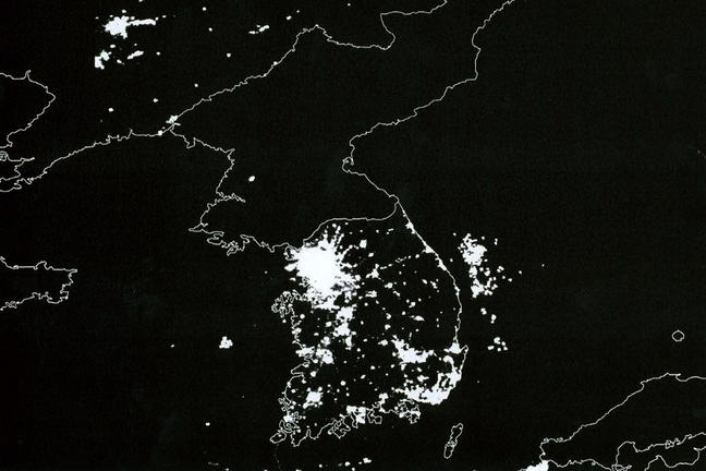 Korean Peninsula at night. South Korea is filled with lights and energy and vitality and a booming economy; North Korea is dark.