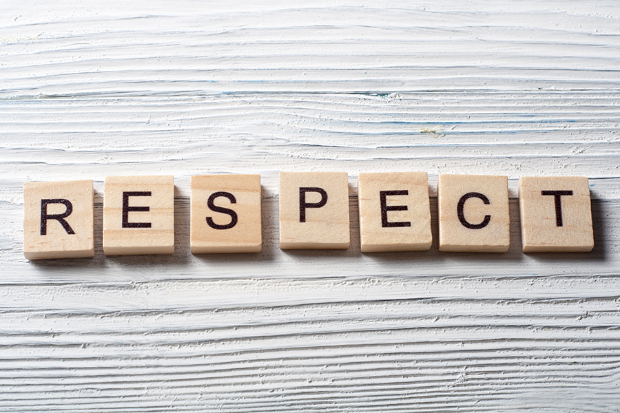 Wooden tiles are laid out to spell the word 'respect'