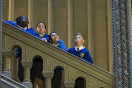 Children from the Colonial Countryside project standing on the stairs at Penrhyn Castle
