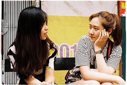 Two female students sit talking