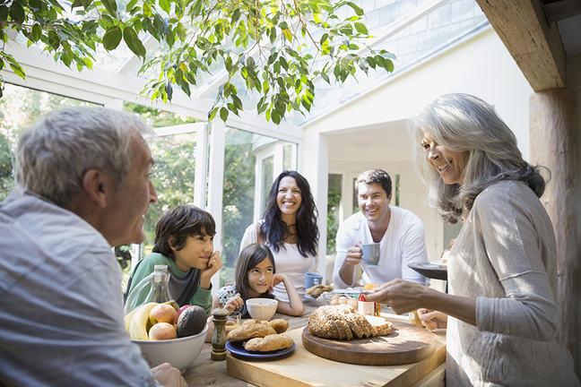 Multi-generation family talking in kitchen