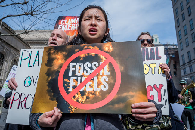 Activists from Rise and Resist, with co-sponsors 350NYC, Food and Water Watch New York, and 350 Brooklyn gathered at the Koch Plaza outside the Metropolitan Museum of Art in NYC to call for urgent action to demand the rejection of climate denial.