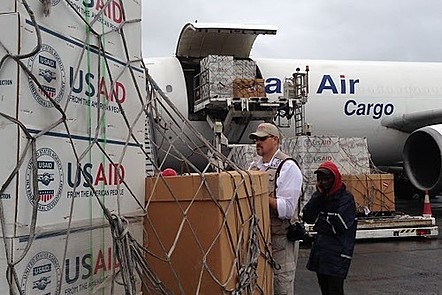 USAID cargo delivery of supplies from aeroplane.