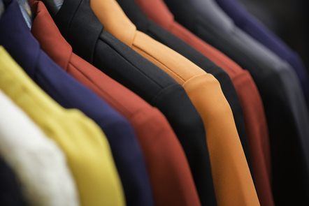 A row of different coloured suits.