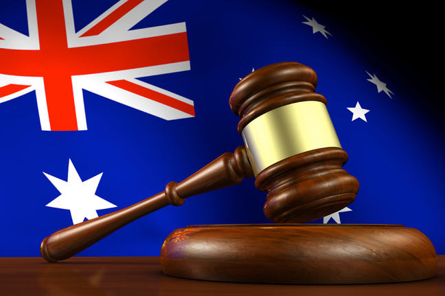 Photograph of gavel with Australian flag in background.