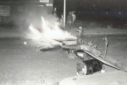 A photograph burning items in the middle of a residential road in Moss Side during the riots of 1981
