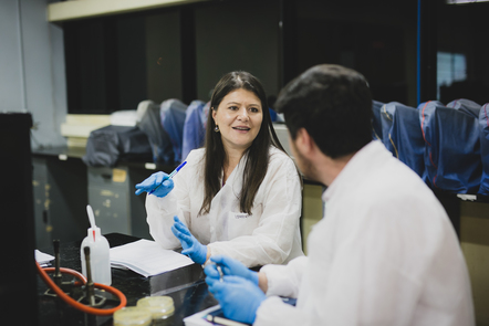 Lab Learners © Pablo Tsukayama Two learners in discussion, wearing laboratory coats and blue gloves, in a science laboratory
