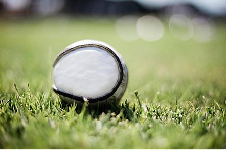 A sliotar on a pitch.