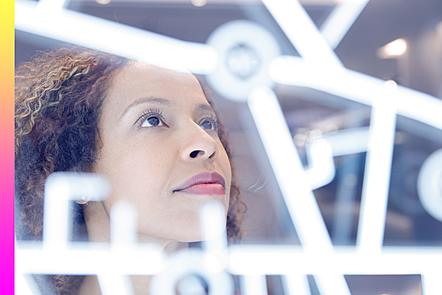 Portrait of woman operating digital interface technology.