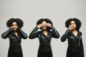 a young black woman in 3 poses: she uses her hands to cover first her ears, then her eyes, then her mouth.