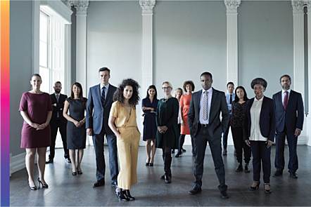 Photographic image of professionally dressed people standing in a room
