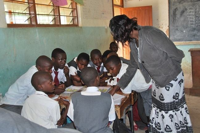 Teacher in Africa in classroom with group of children