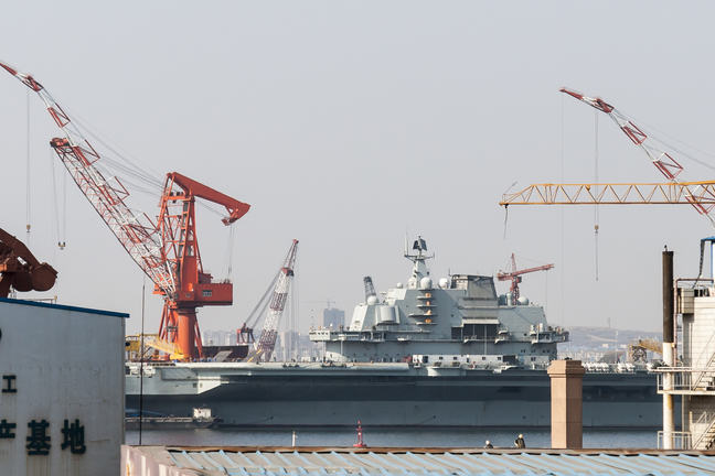 Liaoning (CV-16) Aircraft Carrier during refurbishment in Dalian Shipyard