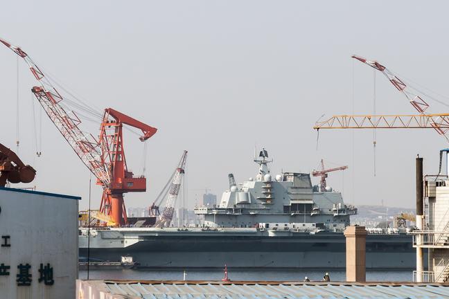 Liaoning (CV-16) Aircraft Carrier during refurbishment in Dalian Shipyard