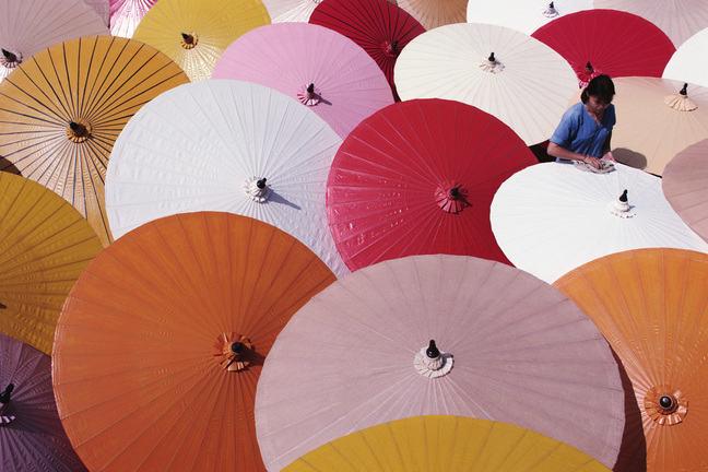 Different coloured paper parasols