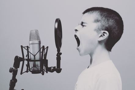 Child shouting into a microphone