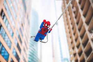 Spiderman lego swinging in city