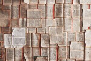 Overhead view of pages from books arranged geometrically