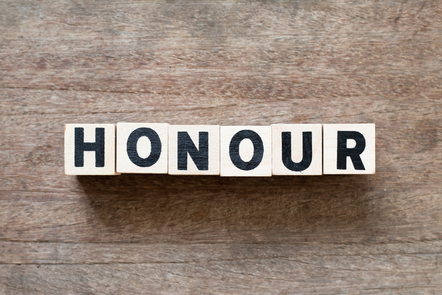 """White blocks with black lettering spelling out the word """"honour"""""""