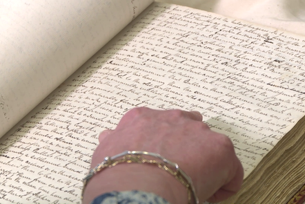 Finger pointing at a word in a hand written manuscript of Walter Scott