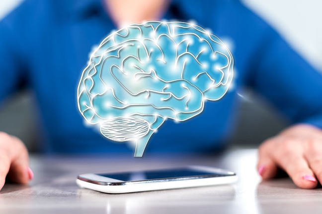 Image of brain floating above mobile phone