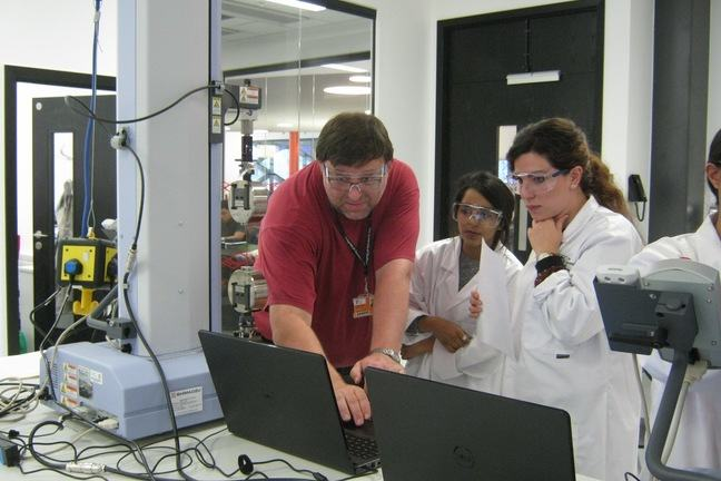 A technician explains a computer read out to a student