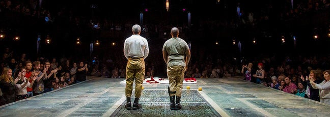 Two actors from the RSC's production of Othello take in the applause from the audience on stage at the Royal Shakespeare Theatre