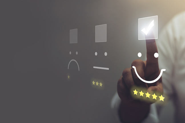 Businessman pressing smiley face emoticon on virtual touch screen. Customer service evaluation concept.