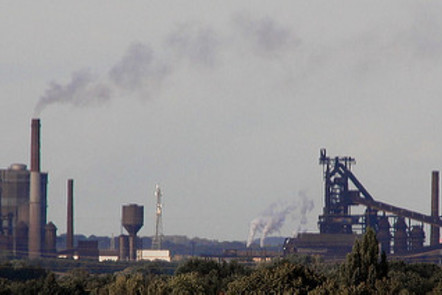 Photograph of factories letting off smoke into the atmosphere