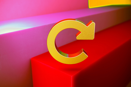 A golden 3D arrow indicating to go back is floating above a red block cube.