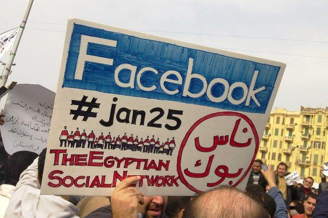 "A placard from the 2011 Egyptian protests, which reads ""Facebook, #jan25 The Egyption Social Network"
