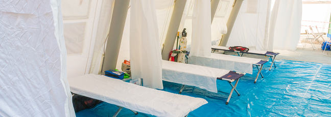 hospital beds in a tent