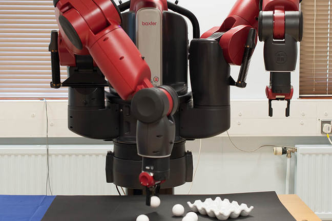 Baxter robot picking up balls