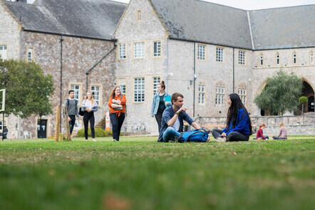 Students sat in the grounds of St Lukes campus
