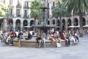 A town square full of people sitting and talking