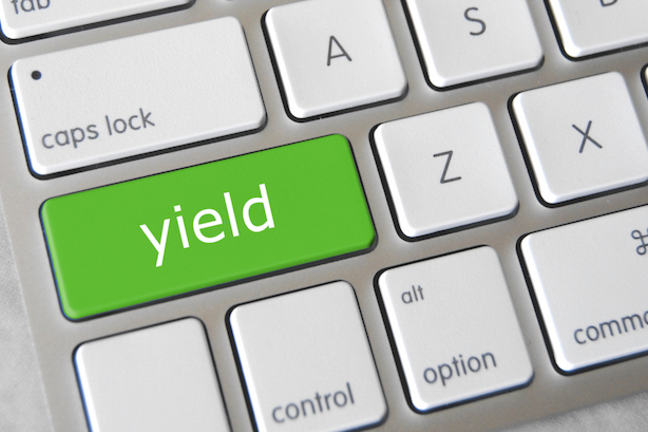 "Computer keyboard with the word ""Yield"" in green as one of the keys"