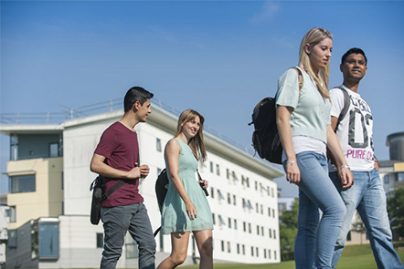 Students walking across UEA campus