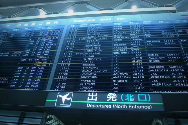 Image of departures board at Narita airport
