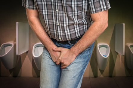 Man with hands holding his crotch, he wants to pee, in lavatory. Stock Media provided by andrianocz / Pond5