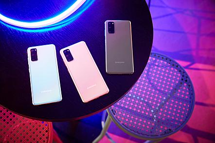 Three Samsung phones on a table