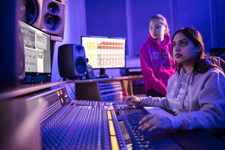 People mixing music in a studio