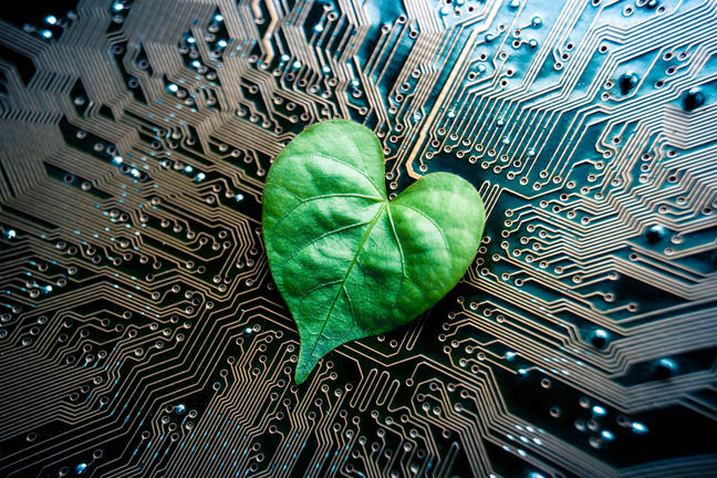A green leaf with a heart shape on a computer circuit board